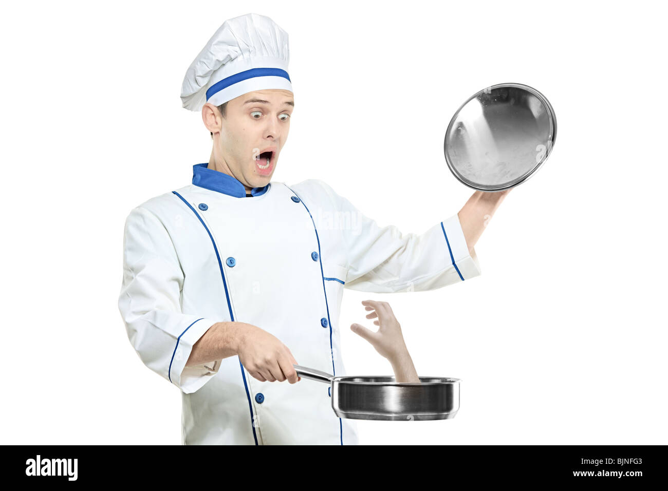 A surprised chef holding a frying pan - Stock Image