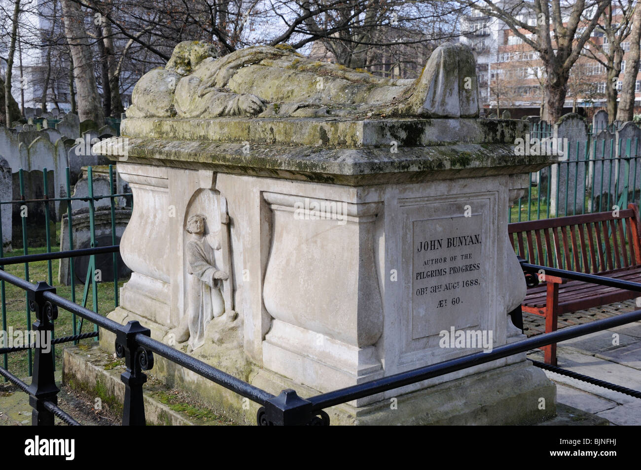 The tombstone of John Bunyan (1628-1688) in Bunhill Fields, City Road, London, England, UK. - Stock Image