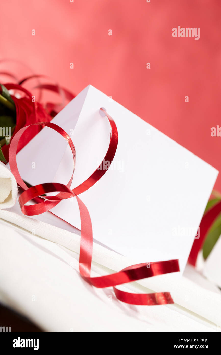 white card note with red ribbon - Stock Image