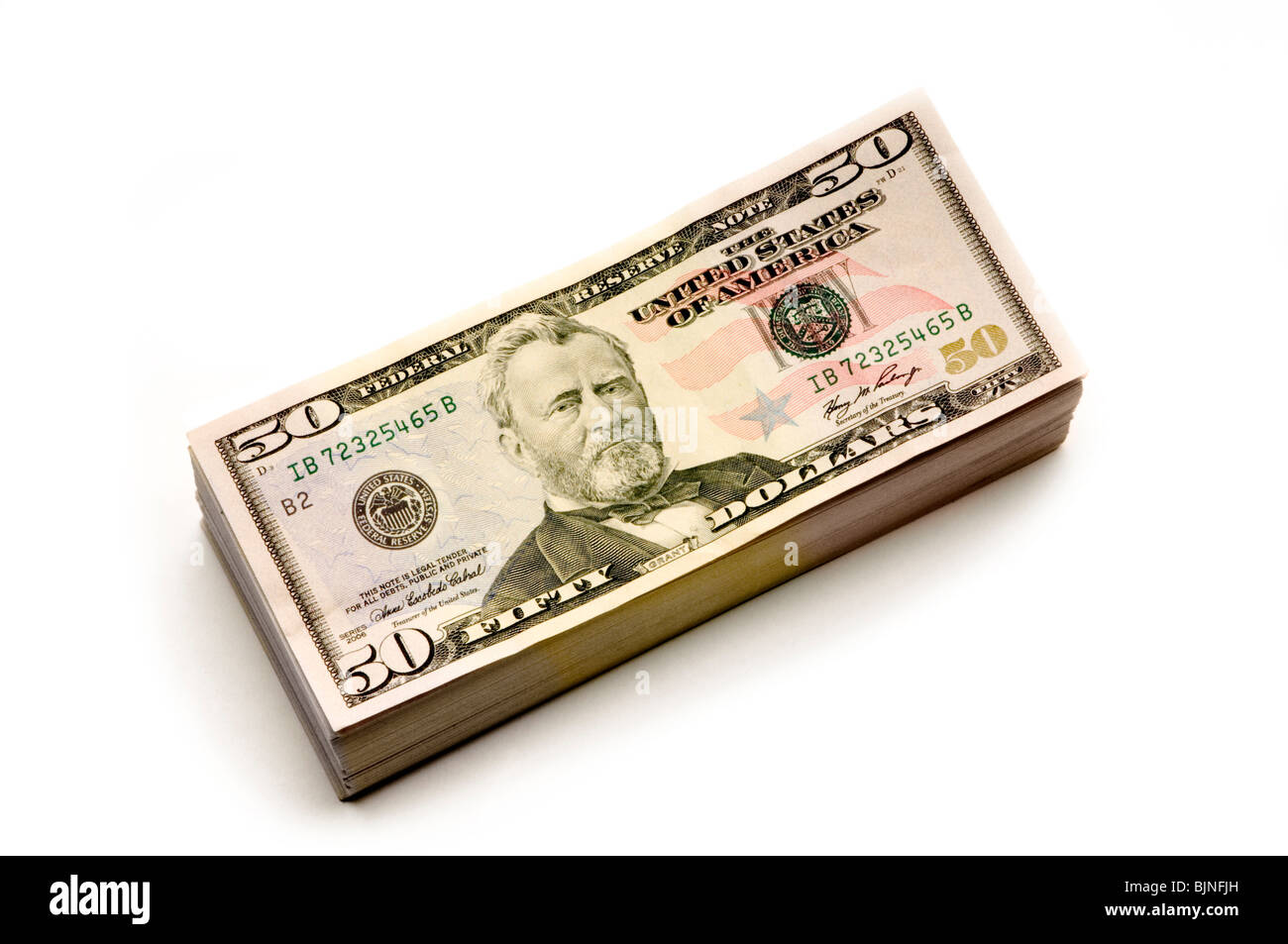 stack of American Money on white background - Stock Image