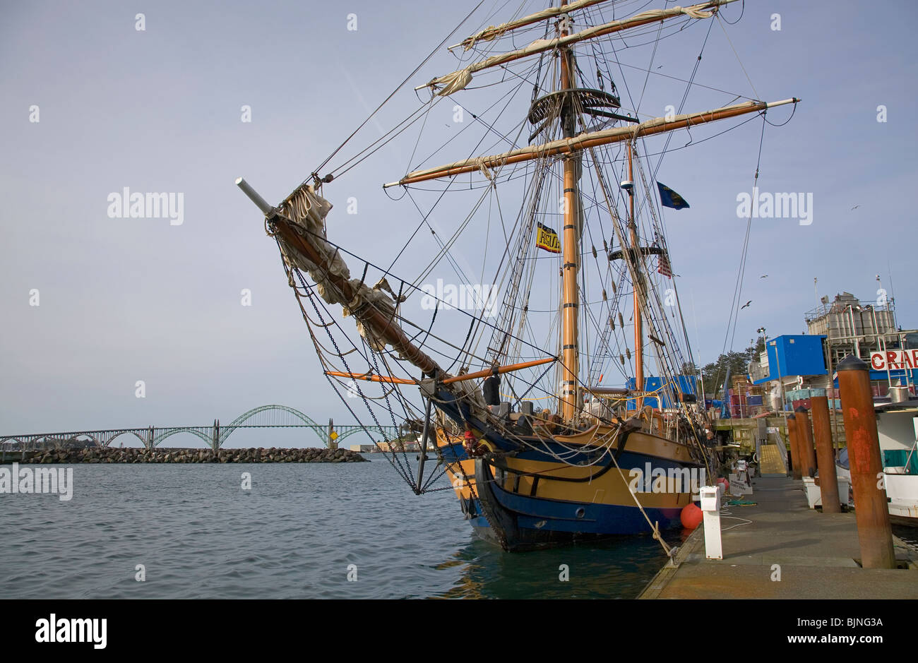 A square rigged tall sailing ship tied to the dock in Newport, Oregon - Stock Image