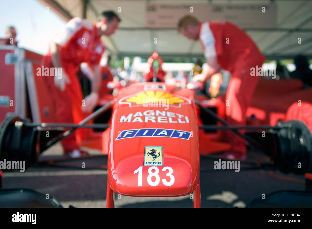 Ferrari mechanics working on a Ferrari F1 car. - Stock Image