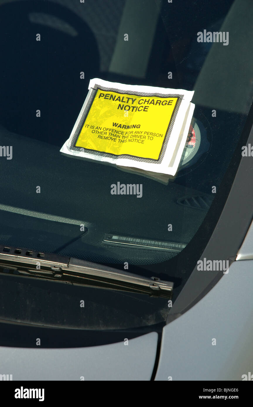 penalty charge notice attached to the windscreen of an illegally parked car, England, UK - Stock Image