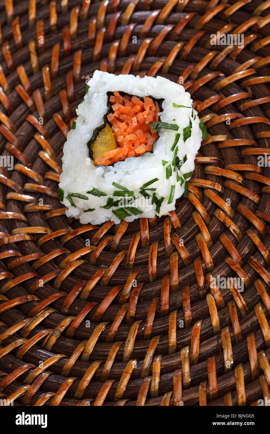 Sushi chopsticks Japan Japanese healthy food salmon rice fish roll raw caviar ginger selection plate traditional - Stock Image