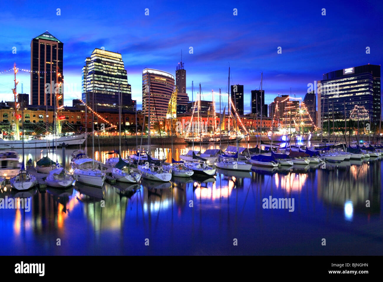perspective view of Puerto Madero yatch club view at twilight with frigates. Buenos Aires, Argentina, south America - Stock Image
