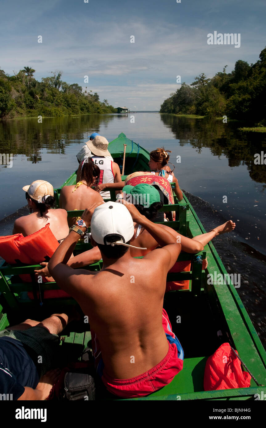 Ecotourism in Amazon rain forest  Tourists in a boat ride at Rio