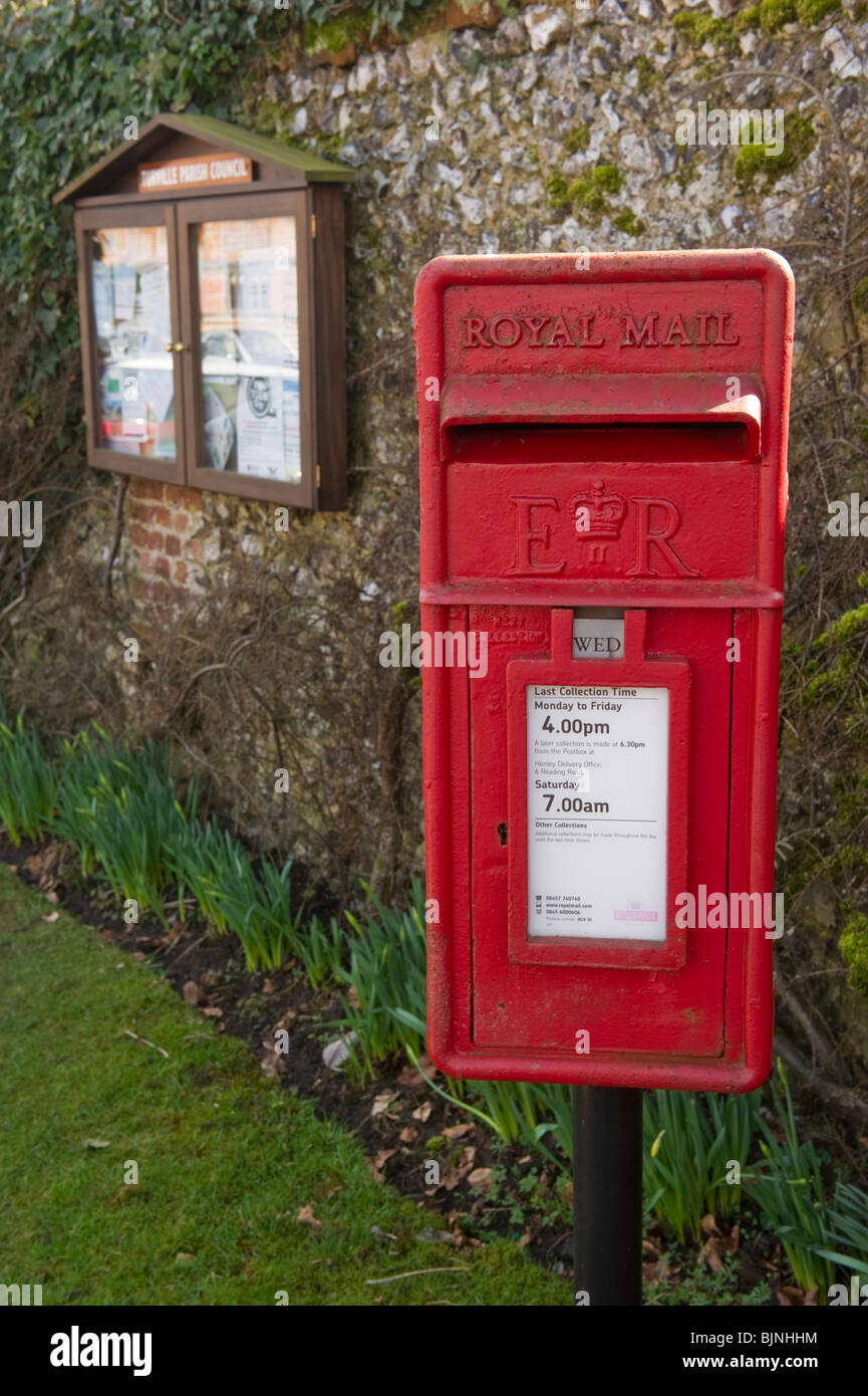Royal Mail red letter box and village notice board in Turville Buckinghamshire UK - Stock Image