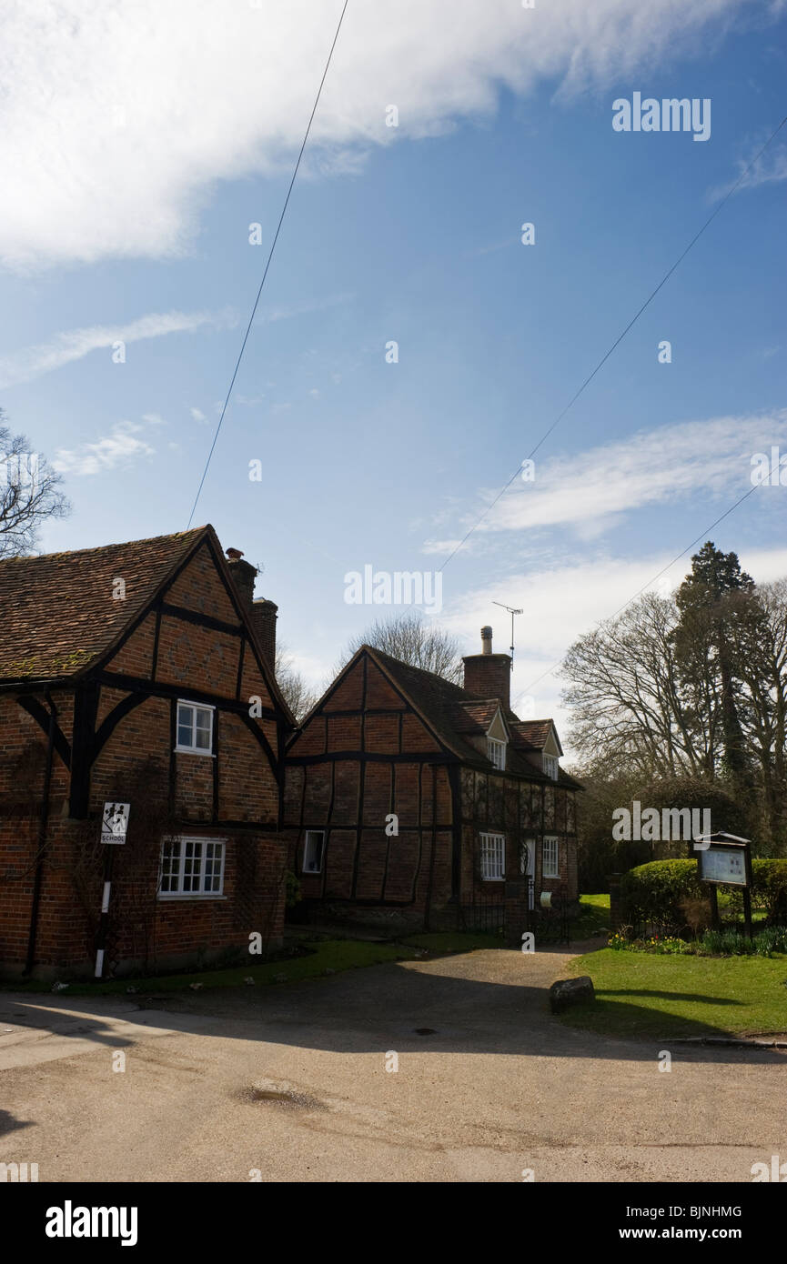 Traditional red brick built timbered cottages and houses in Turville village Buckinghamshire UK - Stock Image