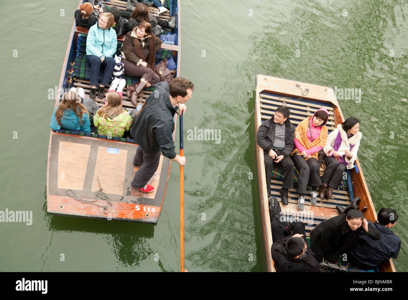 Teenagers in two punts, seen from above, River Cam, Cambridge UK - Stock Image