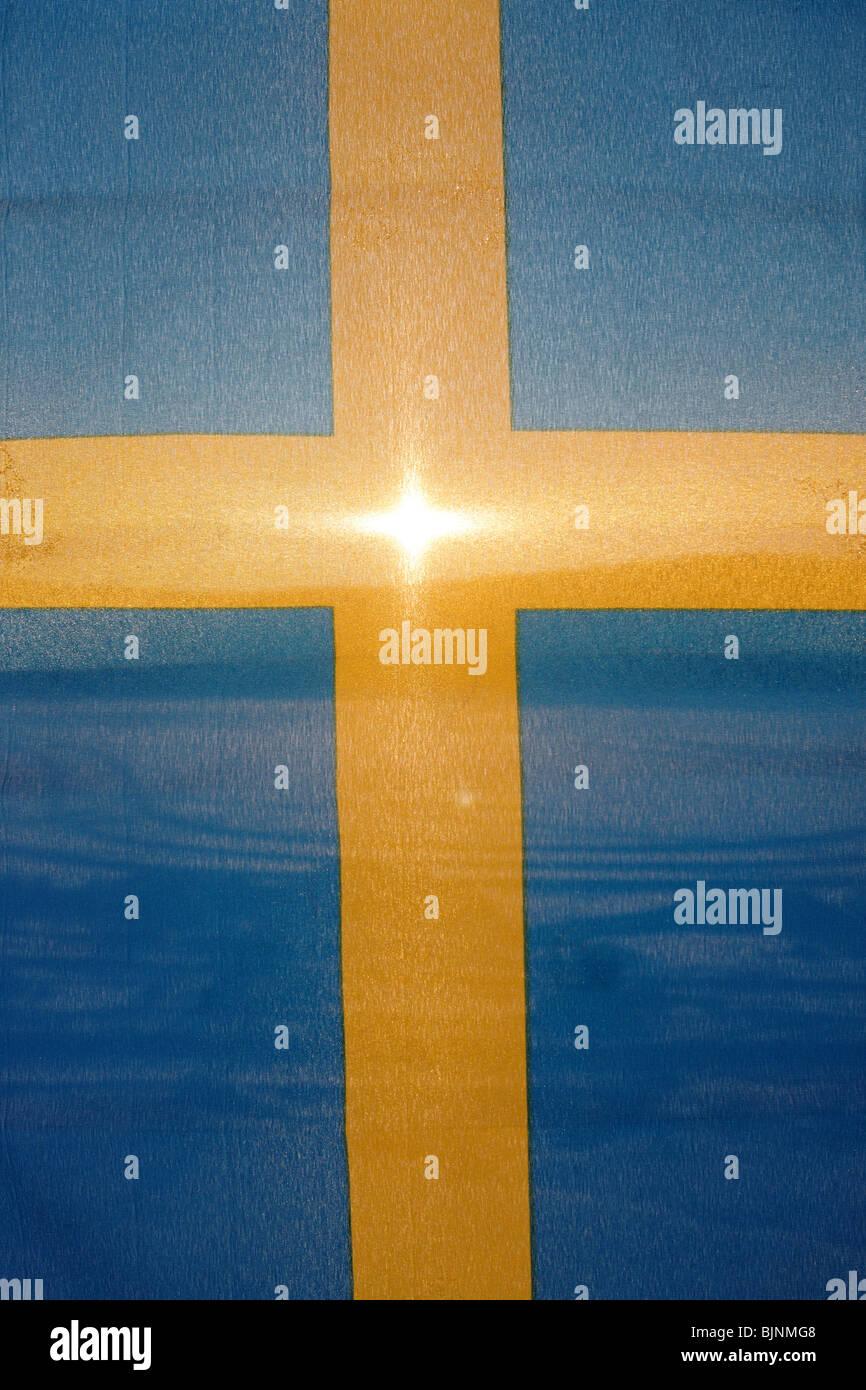 Swedish flag on the background of the rising polar sun in Jokkmokk in Lapland - Stock Image