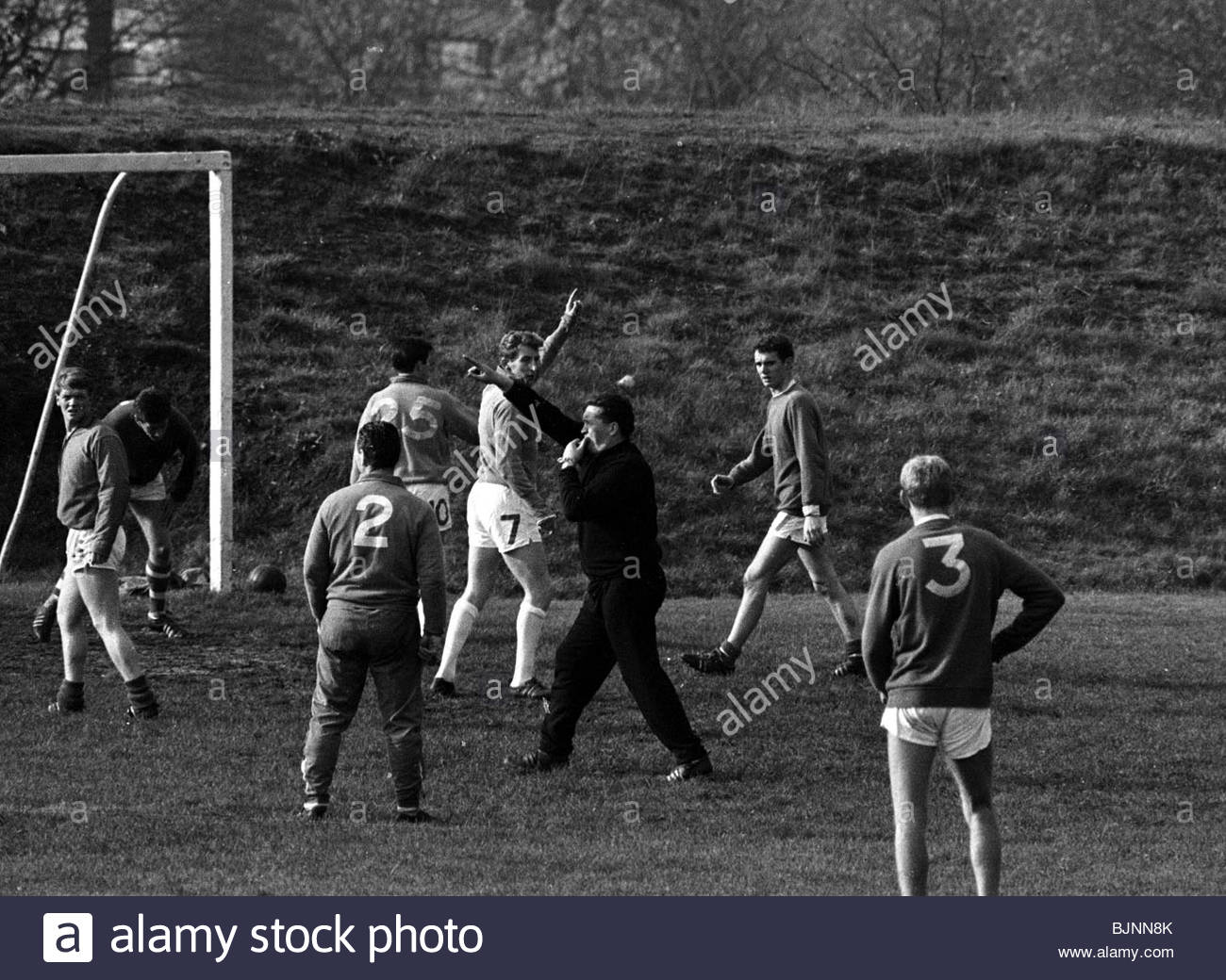 SEASON 1965/1966 CELTIC Manager Jock Stein (centre) calls the shots at Barrowfield training - Stock Image