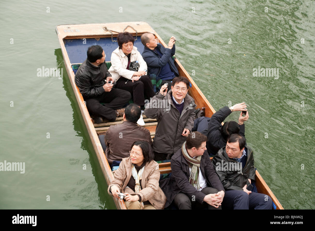 Japanese tourists in a punt, River Cam, Cambridge UK Stock Photo