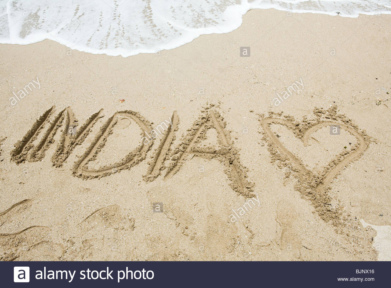India written in sand - Stock Image