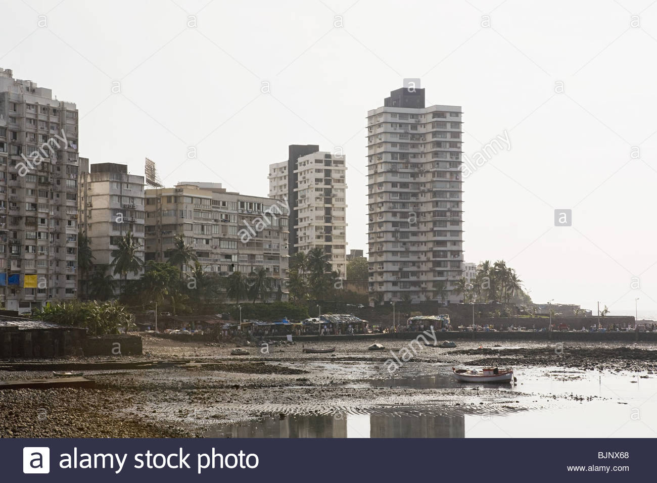 Multistorey structures and a beach - Stock Image