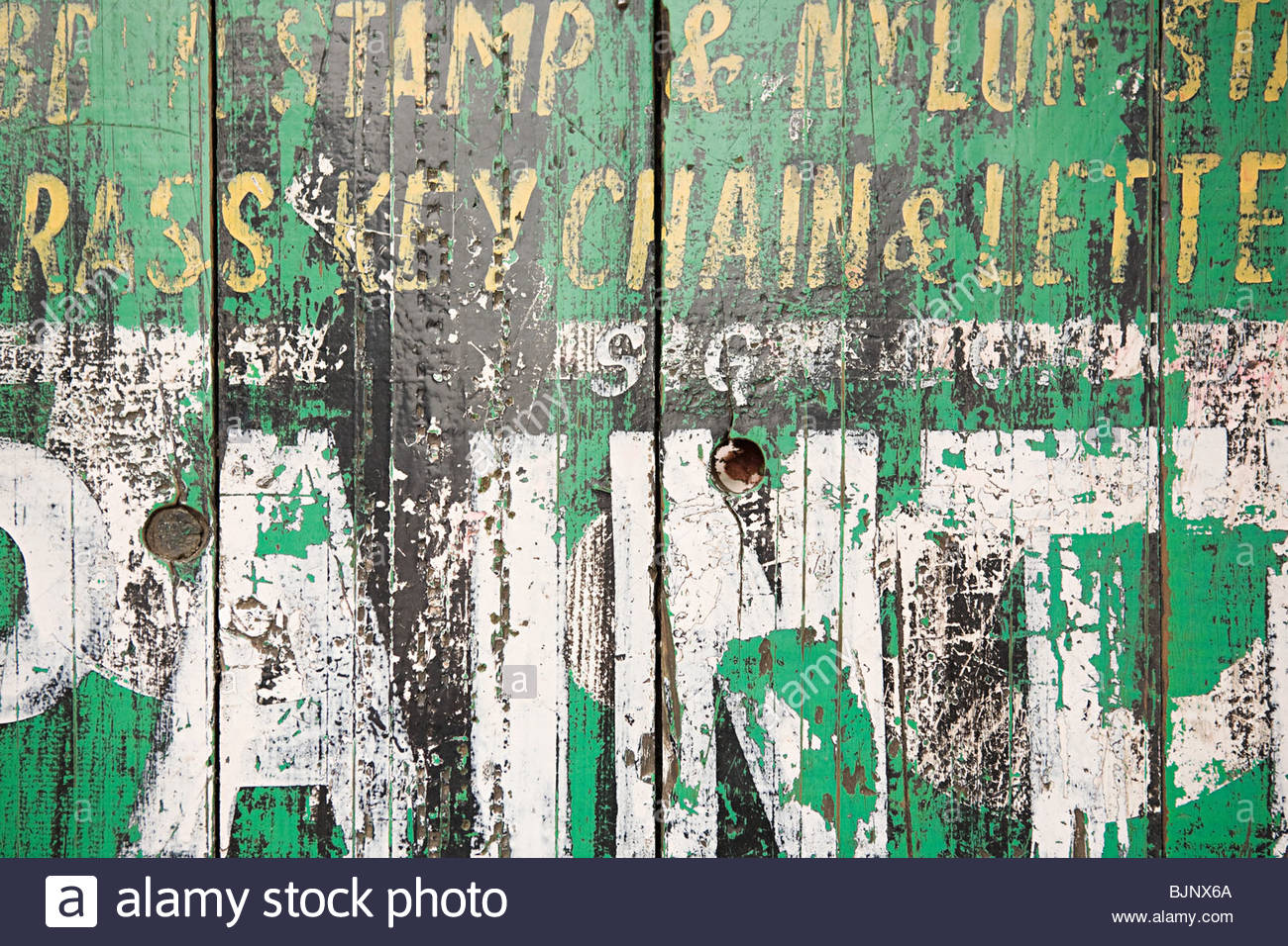 Worn paint on a gate - Stock Image