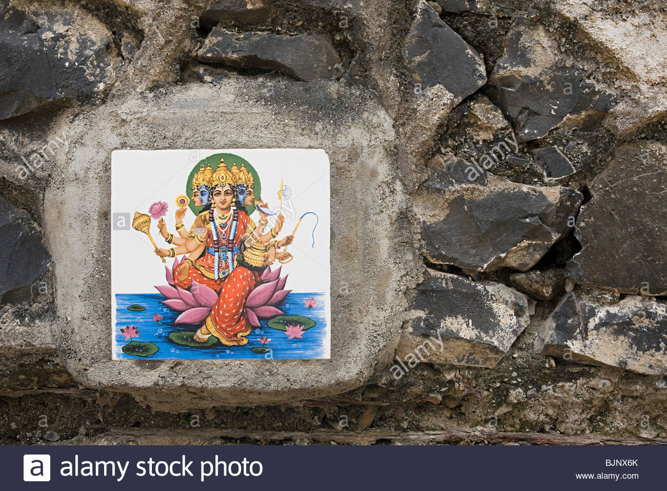 A tile of the mother godess on a wall - Stock Image