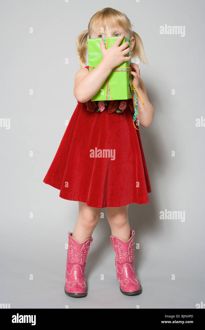 Girl with a birthday gift - Stock Image