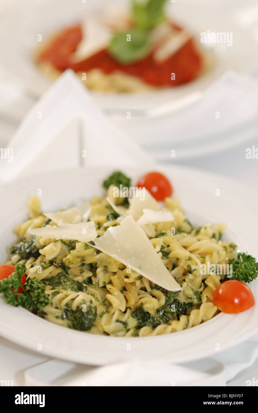 Pasta fussili with spinach and sauce of white wine and cheese - Stock Image