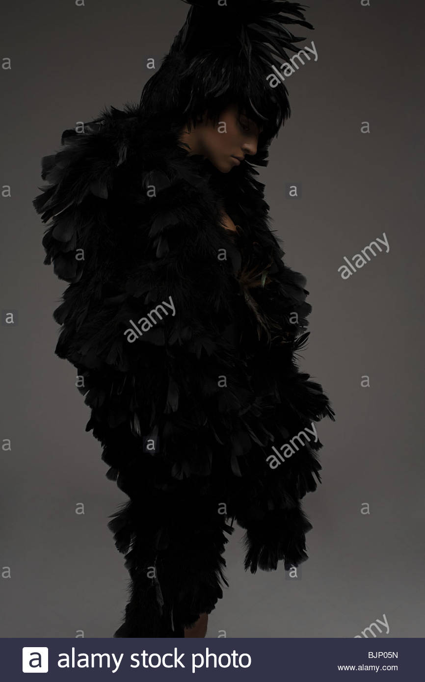 A woman dressed in a feather outfit - Stock Image