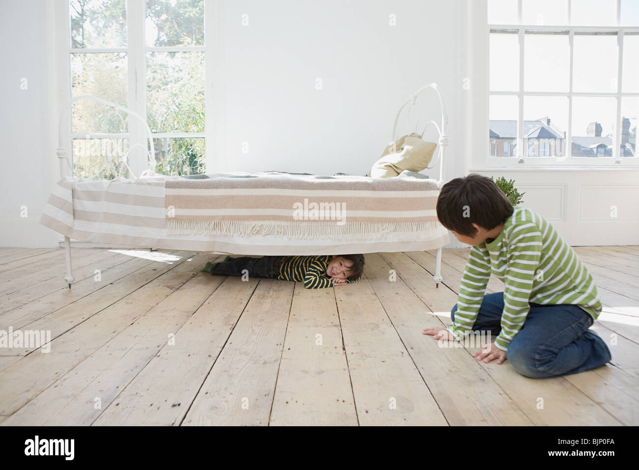 Boys playing hide and seek - Stock Image