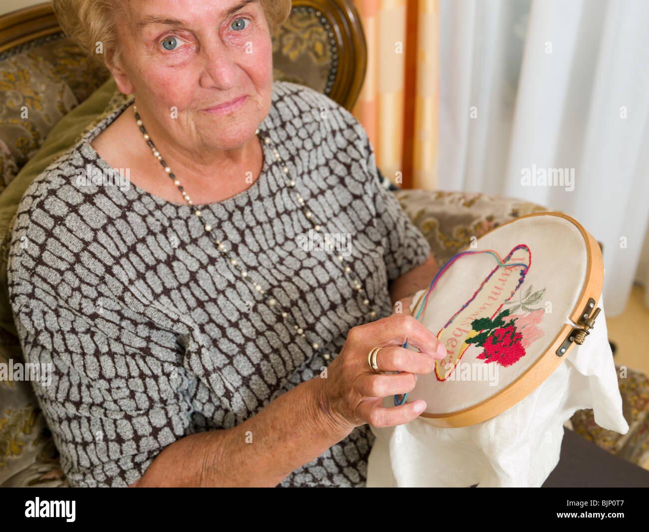Senior woman doing crochet - Stock Image
