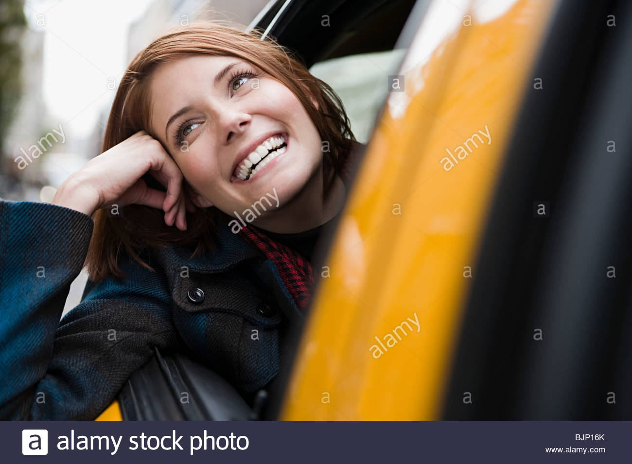 Young woman in a taxicab Stock Photo