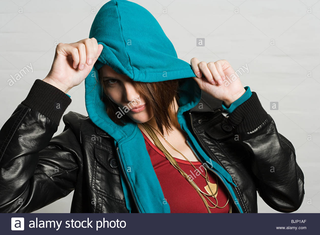 Young woman in hooded top - Stock Image
