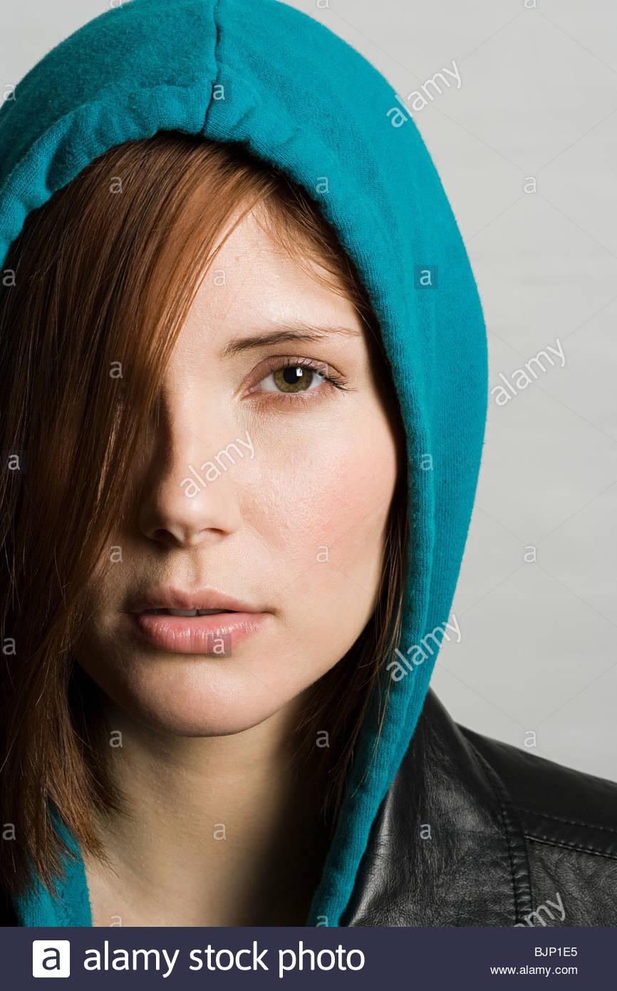 Woman wearing hood - Stock Image