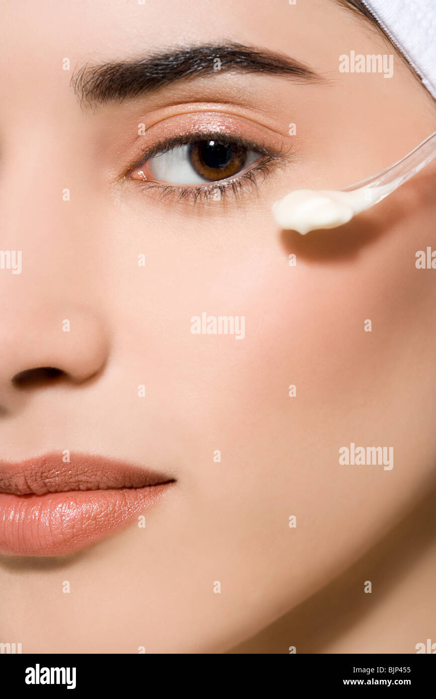 Woman with cosmetic cream - Stock Image
