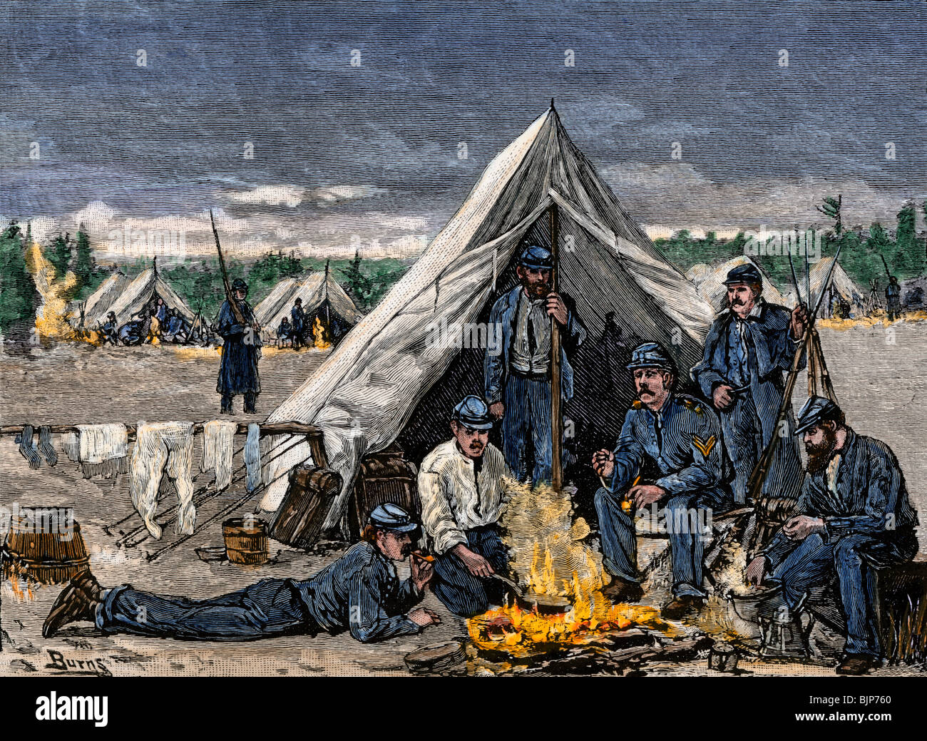 Soldiers of the Seventh New York Regiment around a campfire at Camp Cameron, Washington DC. Hand-colored woodcut - Stock Image