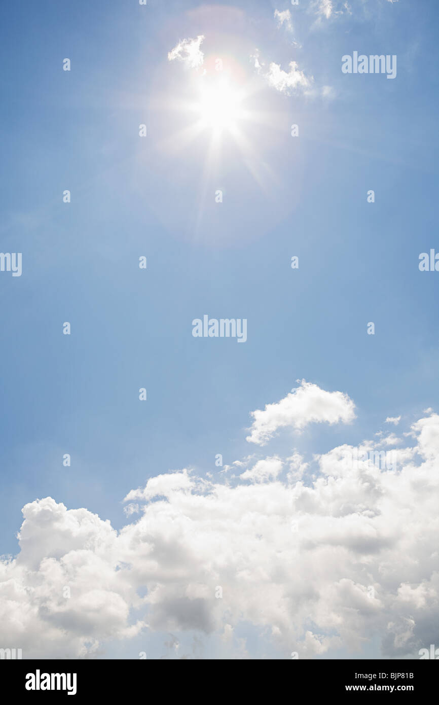 The sun and clouds in the sky - Stock Image