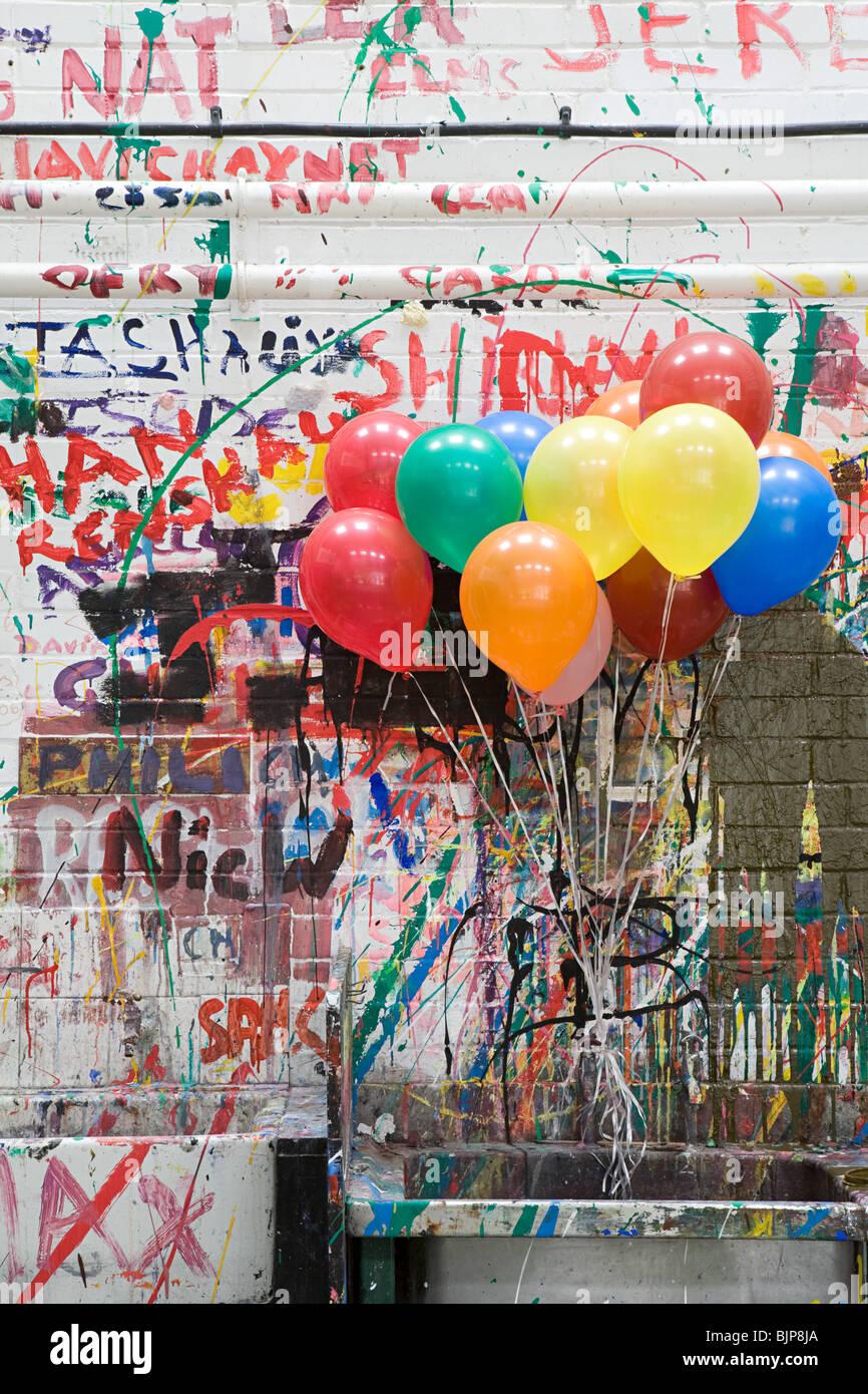 Balloons in art classroom - Stock Image