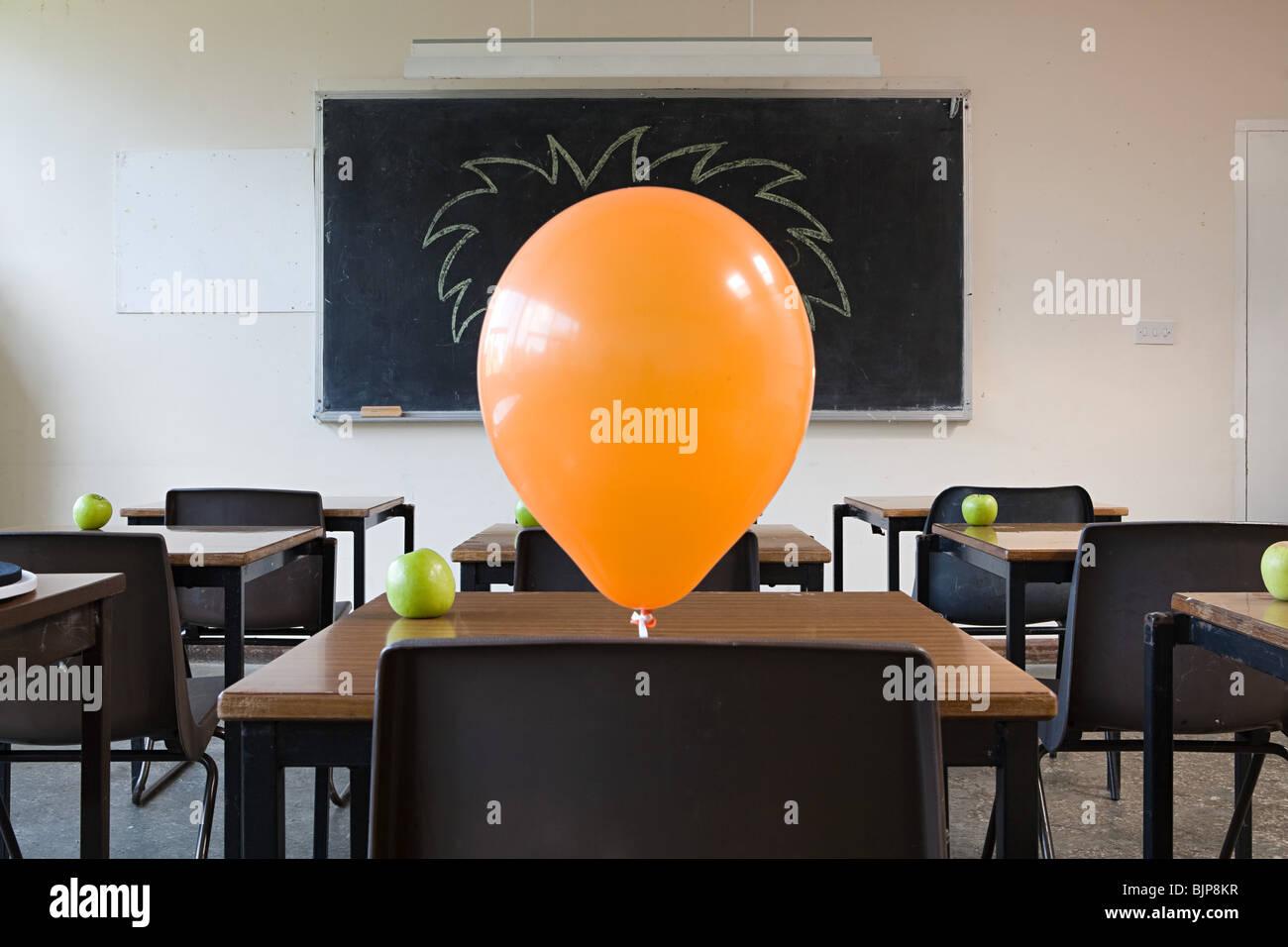 Balloon in classroom - Stock Image