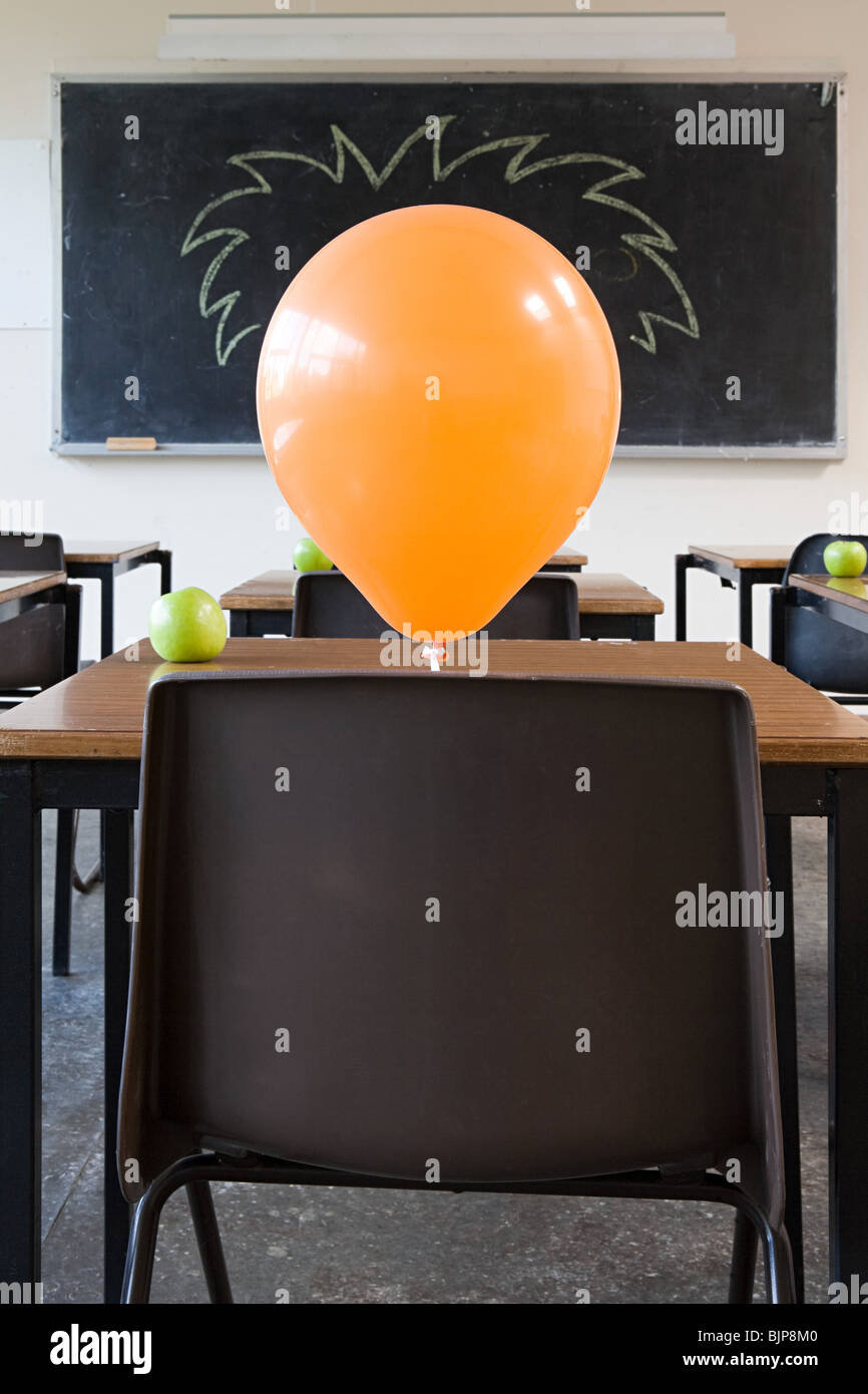 Balloons in classroom - Stock Image