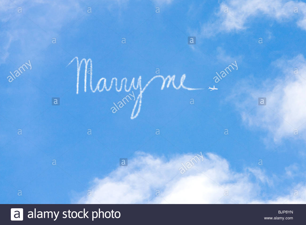 Proposal written in vapour trail - Stock Image