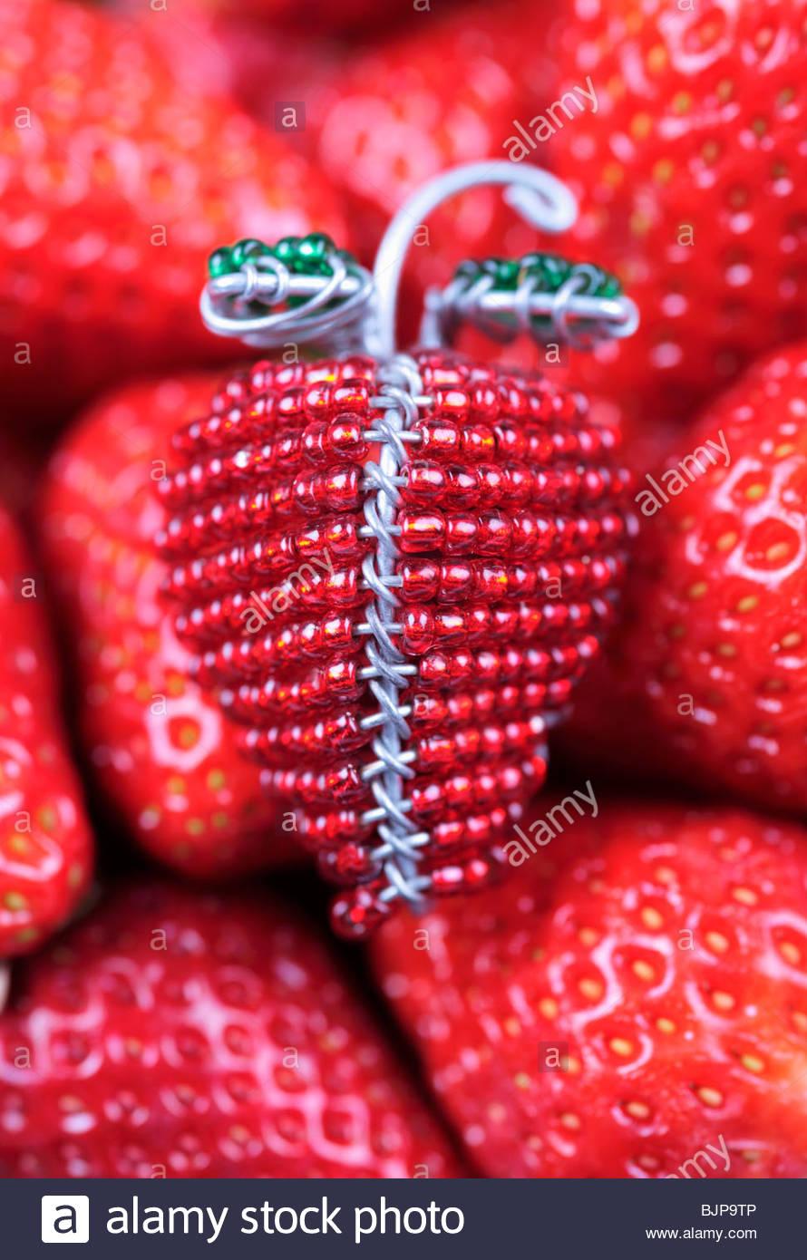 Beaded strawberry on fresh strawberries - Stock Image