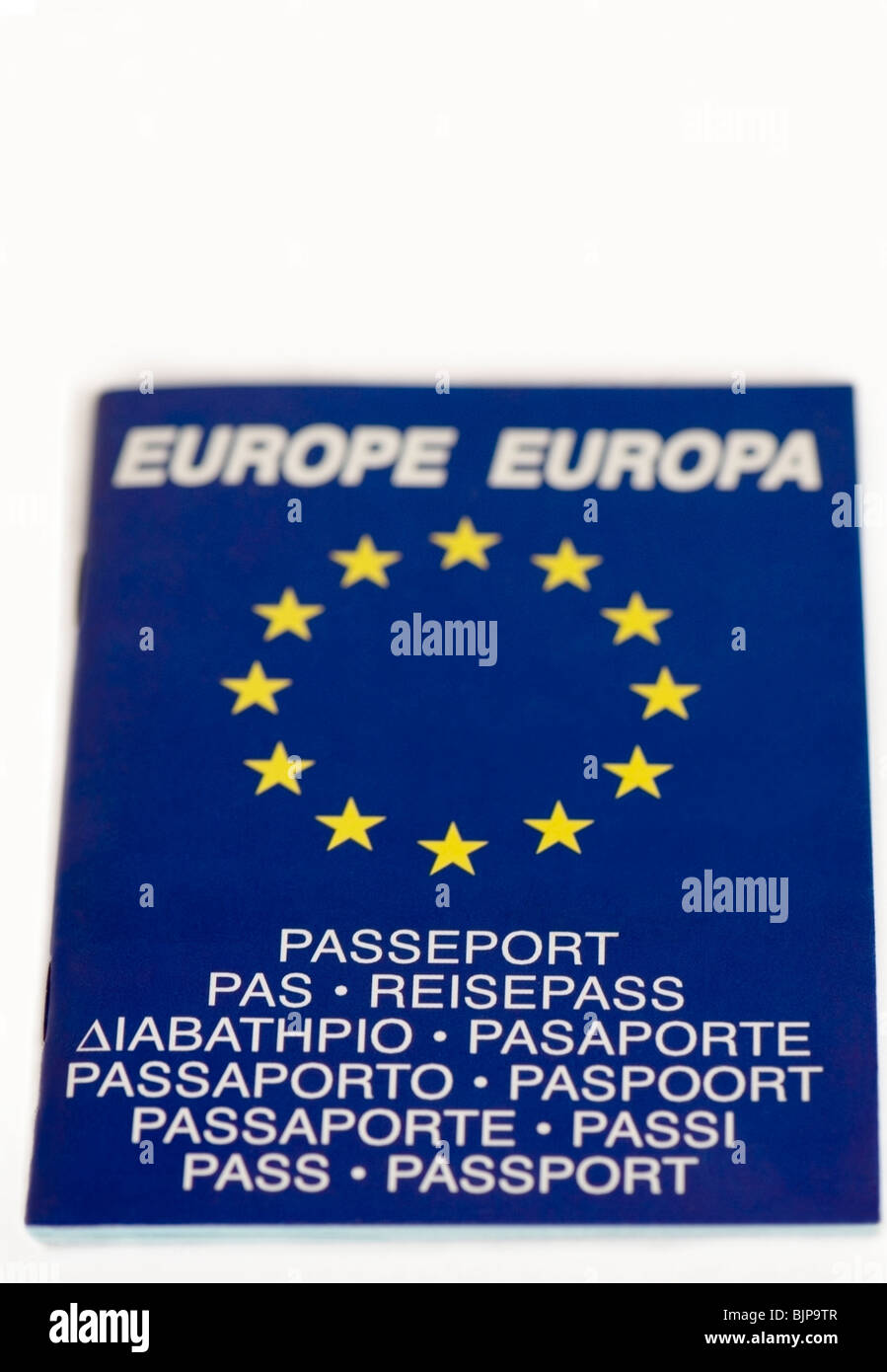 Bilingual writing, words, European Union passport with yellow iconic stars, graphics on white background, Europe, - Stock Image