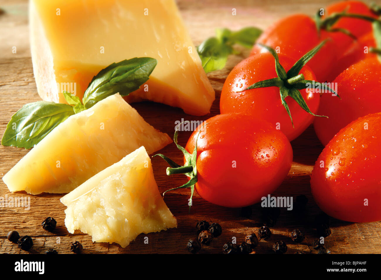 Cheddar cheese and fresh tomatoes food photos. - Stock Image