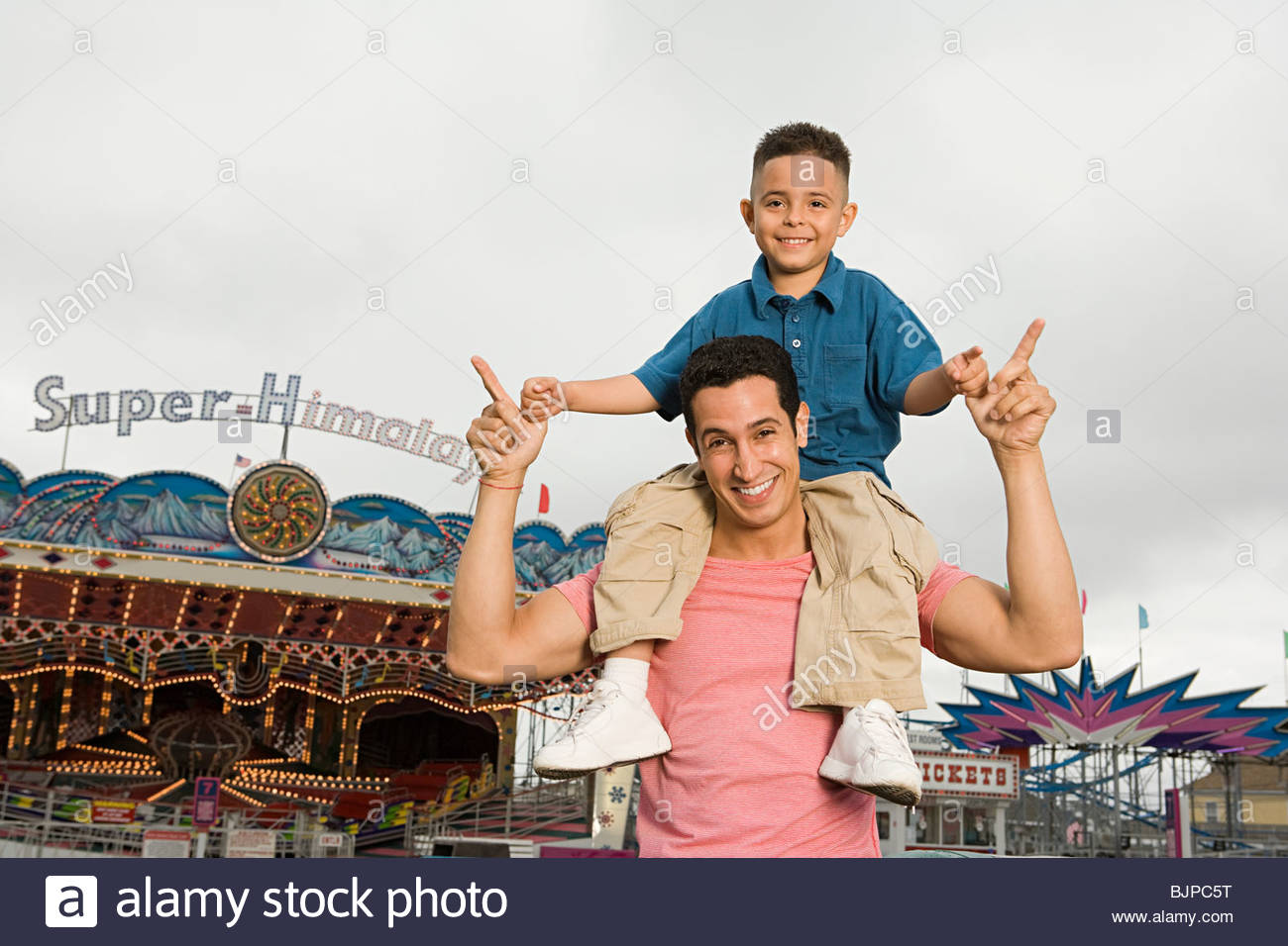 Father and son at amusement park - Stock Image