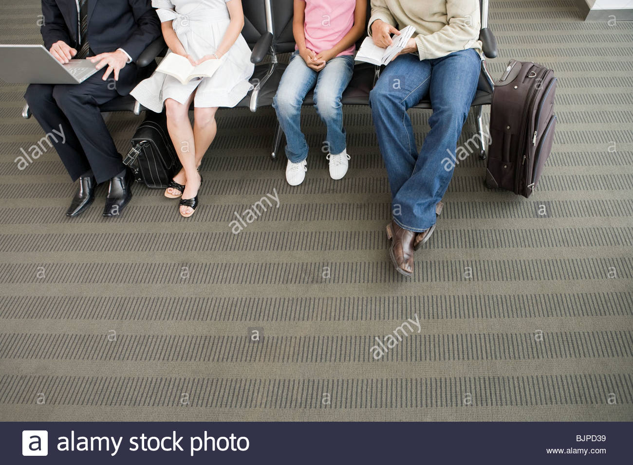 People waiting in the departure lounge - Stock Image