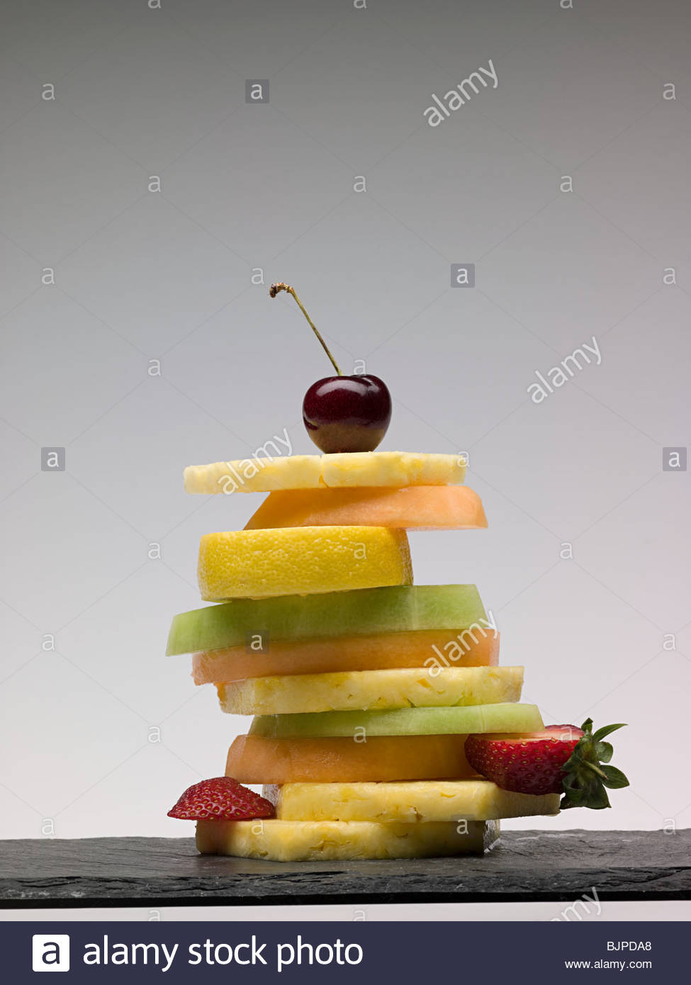 Stack of fruit slices - Stock Image