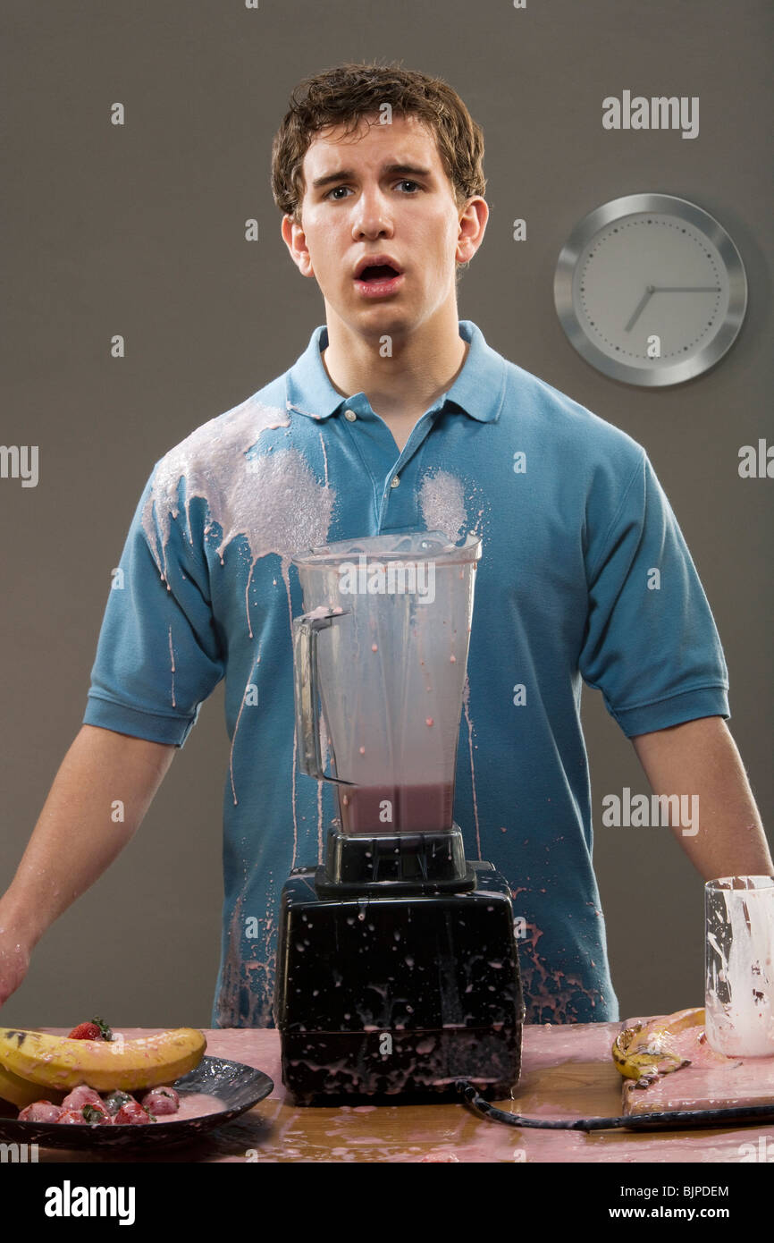 Man with a blender explosion - Stock Image