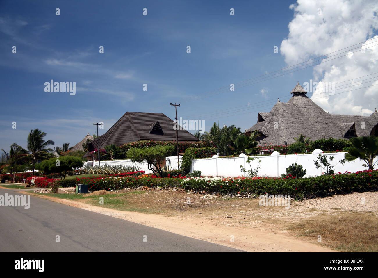 Tourist complex beach road Diani beach Kenya - Stock Image