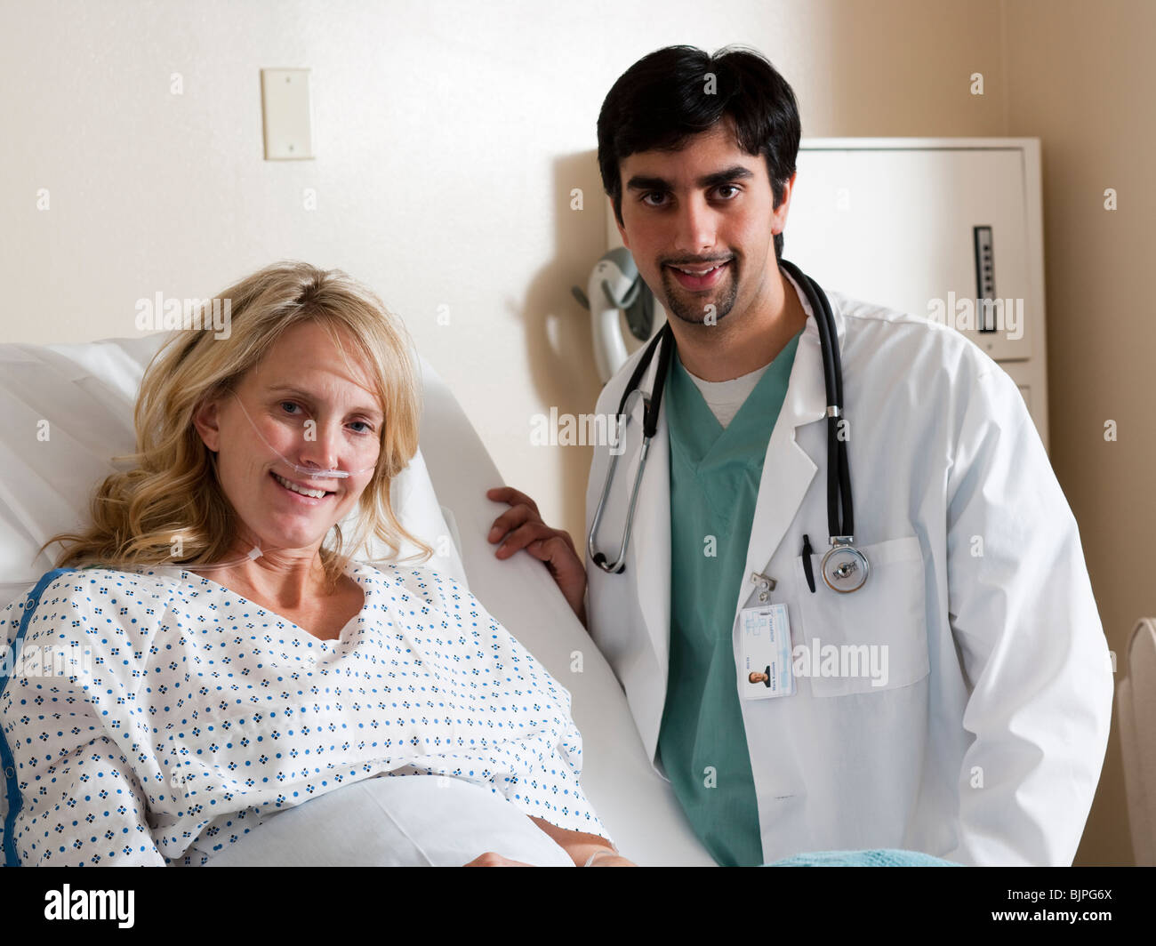 Woman in hospital bed - Stock Image