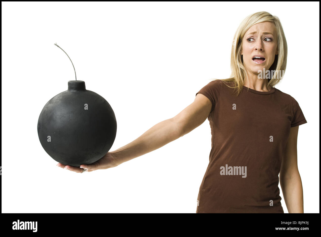 Woman posing and holding bomb - Stock Image