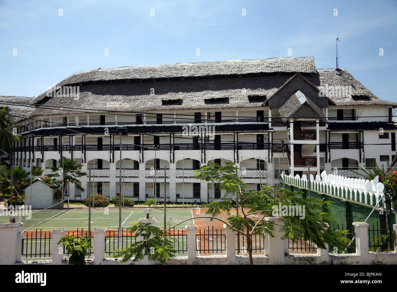 Large hotel complex, beach road Diani beach Kenya - Stock Image