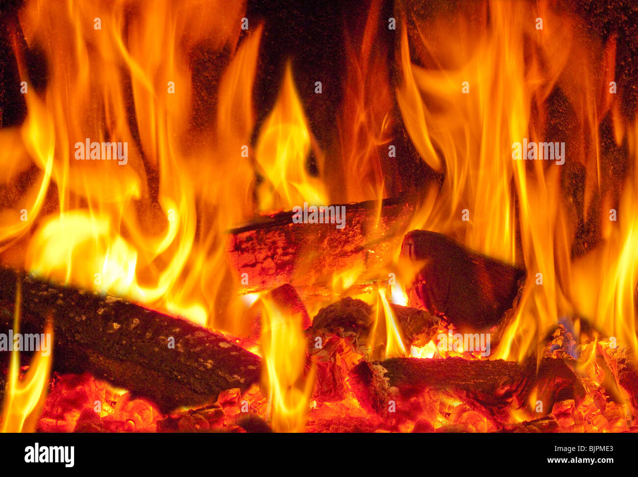 A Blazing Log Fire In A Wood Burning Stove Stock Photo ...