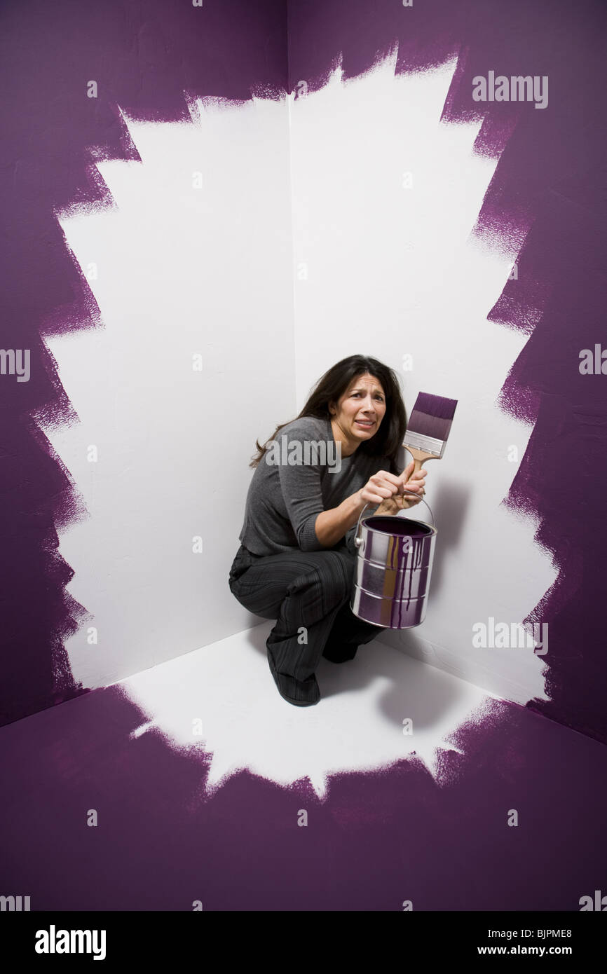 Woman painted into a corner - Stock Image