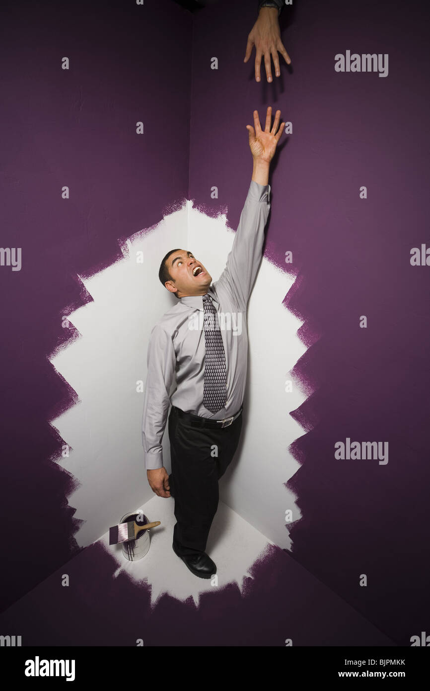 Man reaching for a helping hand - Stock Image