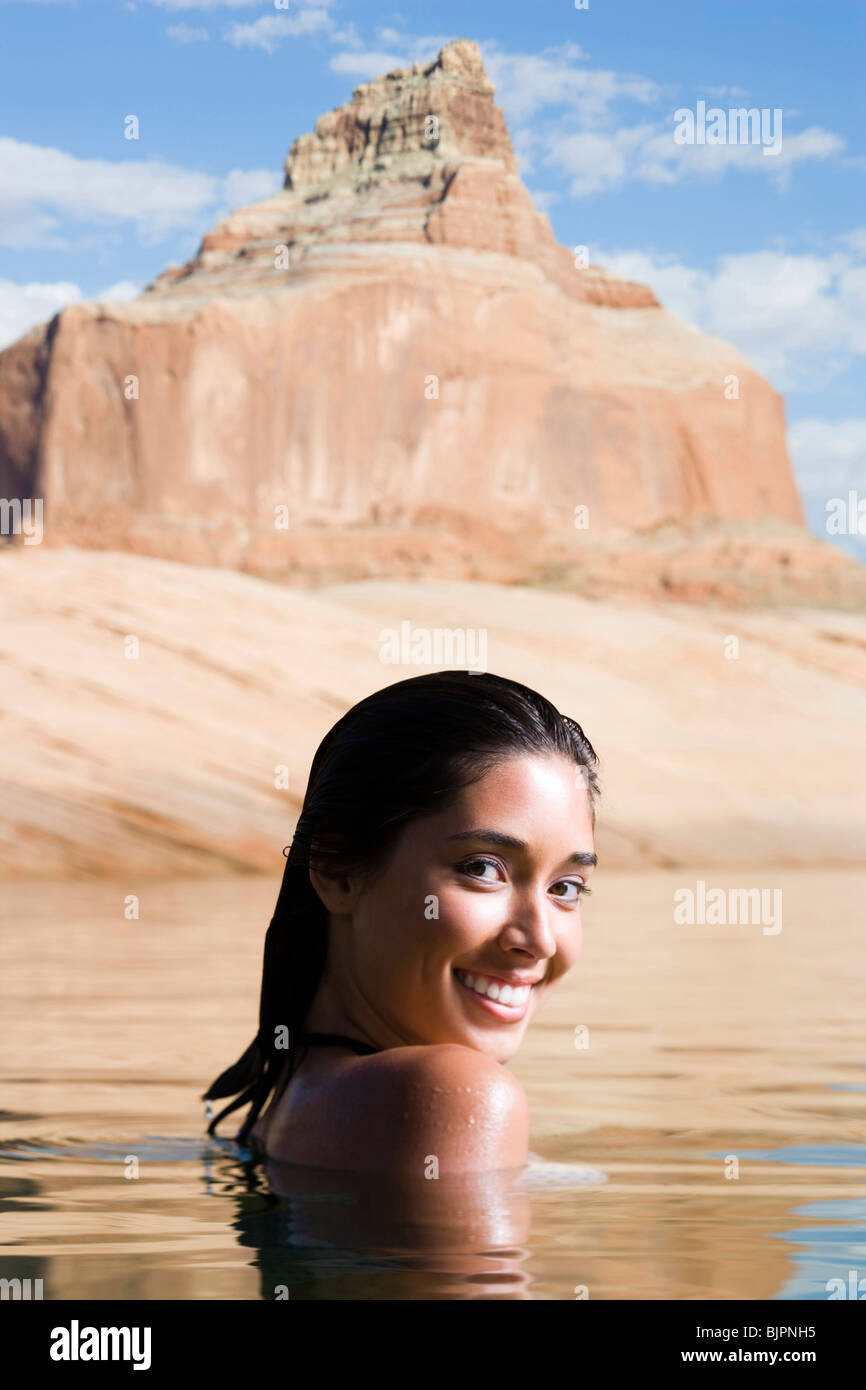 Woman posing with smile in water - Stock Image